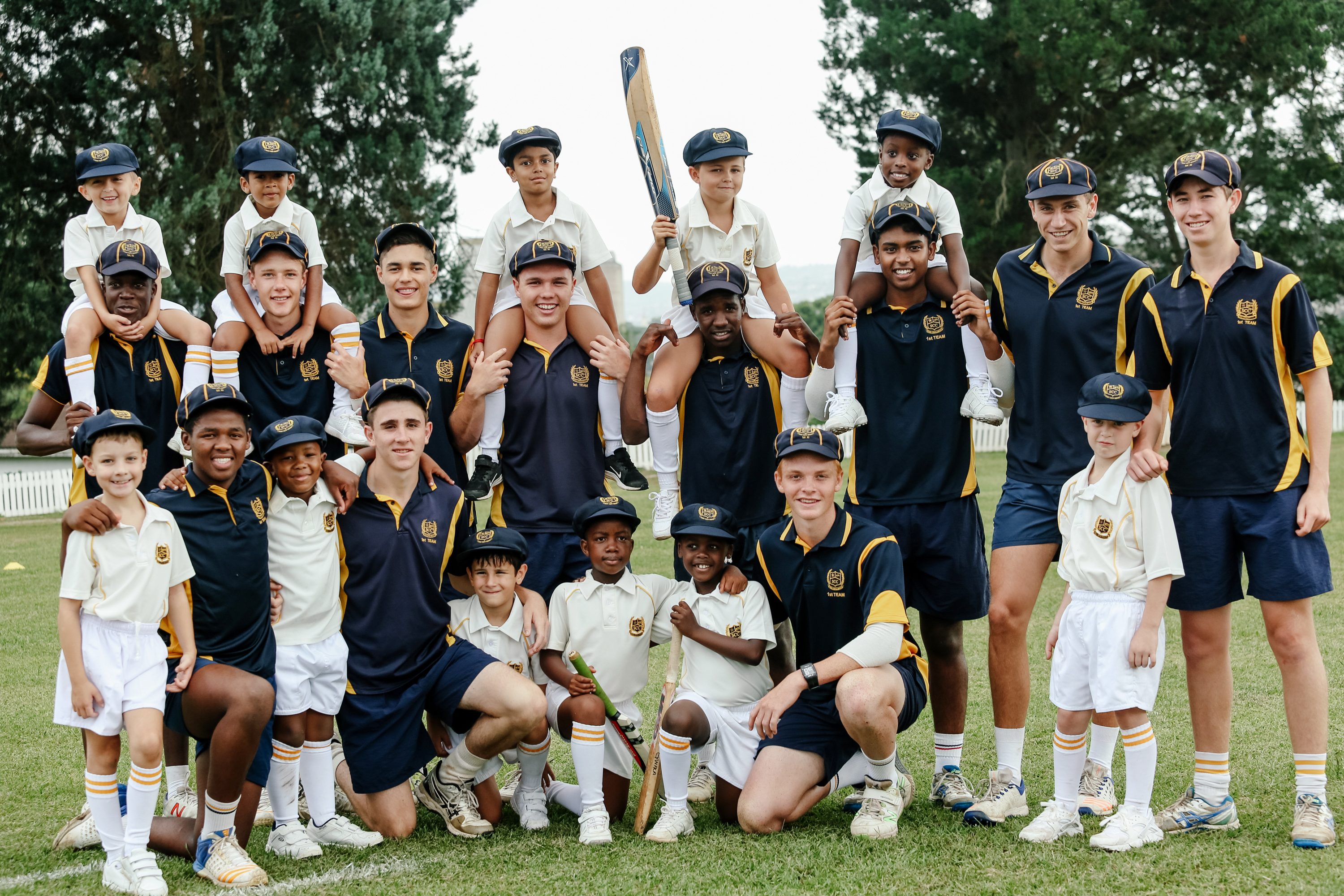 senior and junior cricket teams together