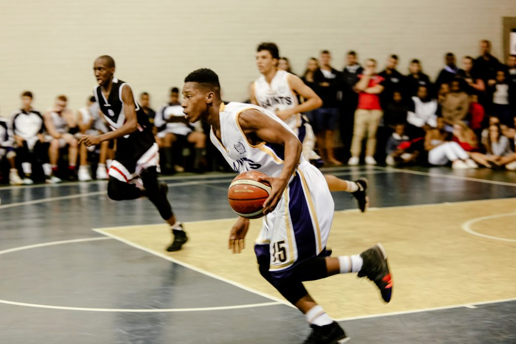 St Charles College Basketball Player running with the ball