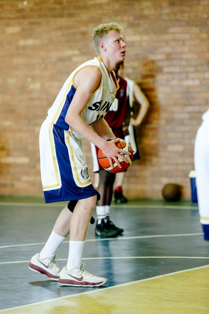 St Charles College player about to shoot the ball