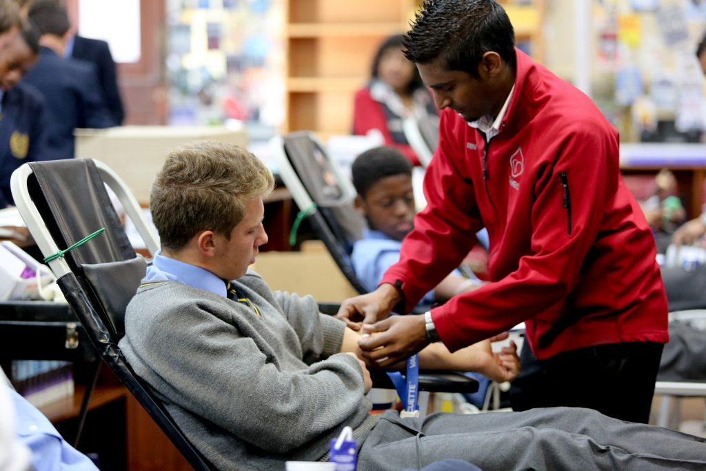 St Charles student donating blood