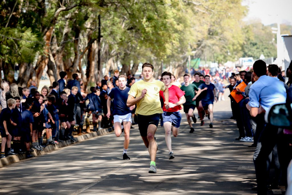 boys running towards the finish line in a running race