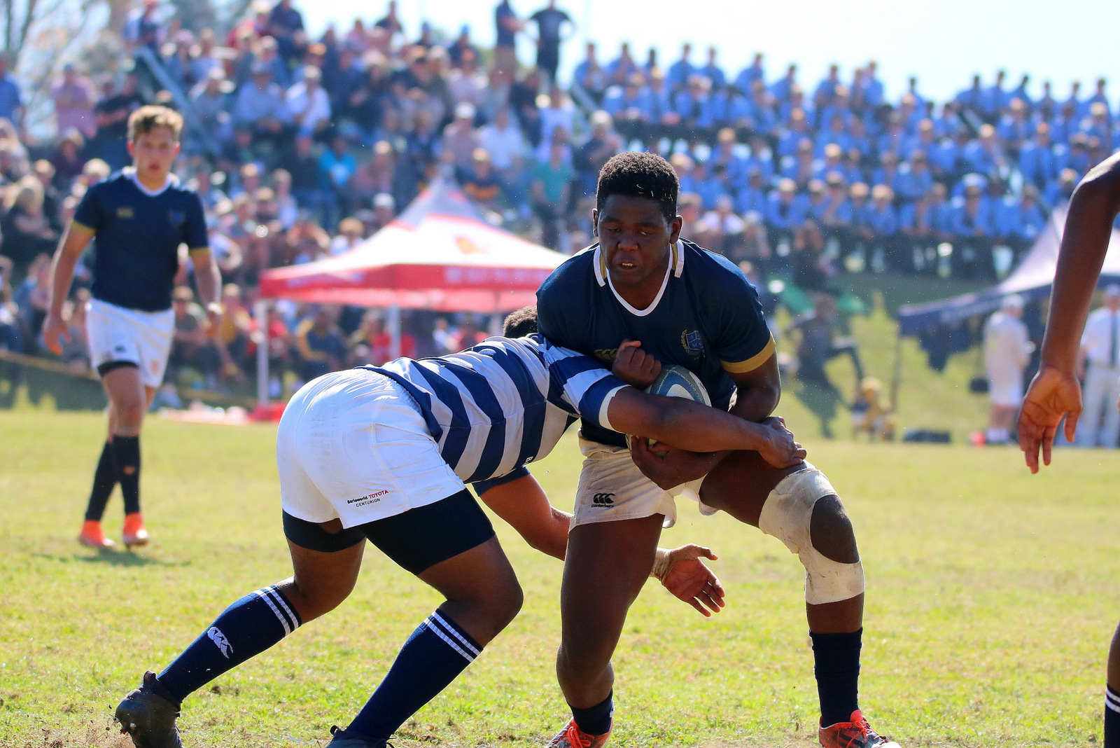st charles rugby player braising for a tackle