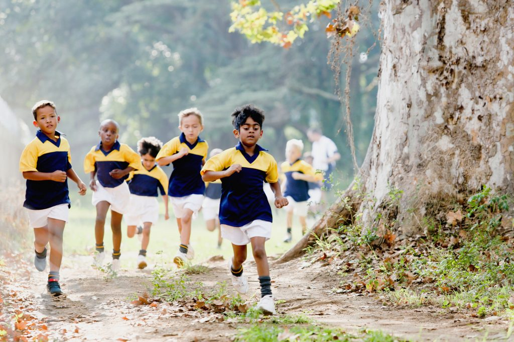 primary school boys running cross country