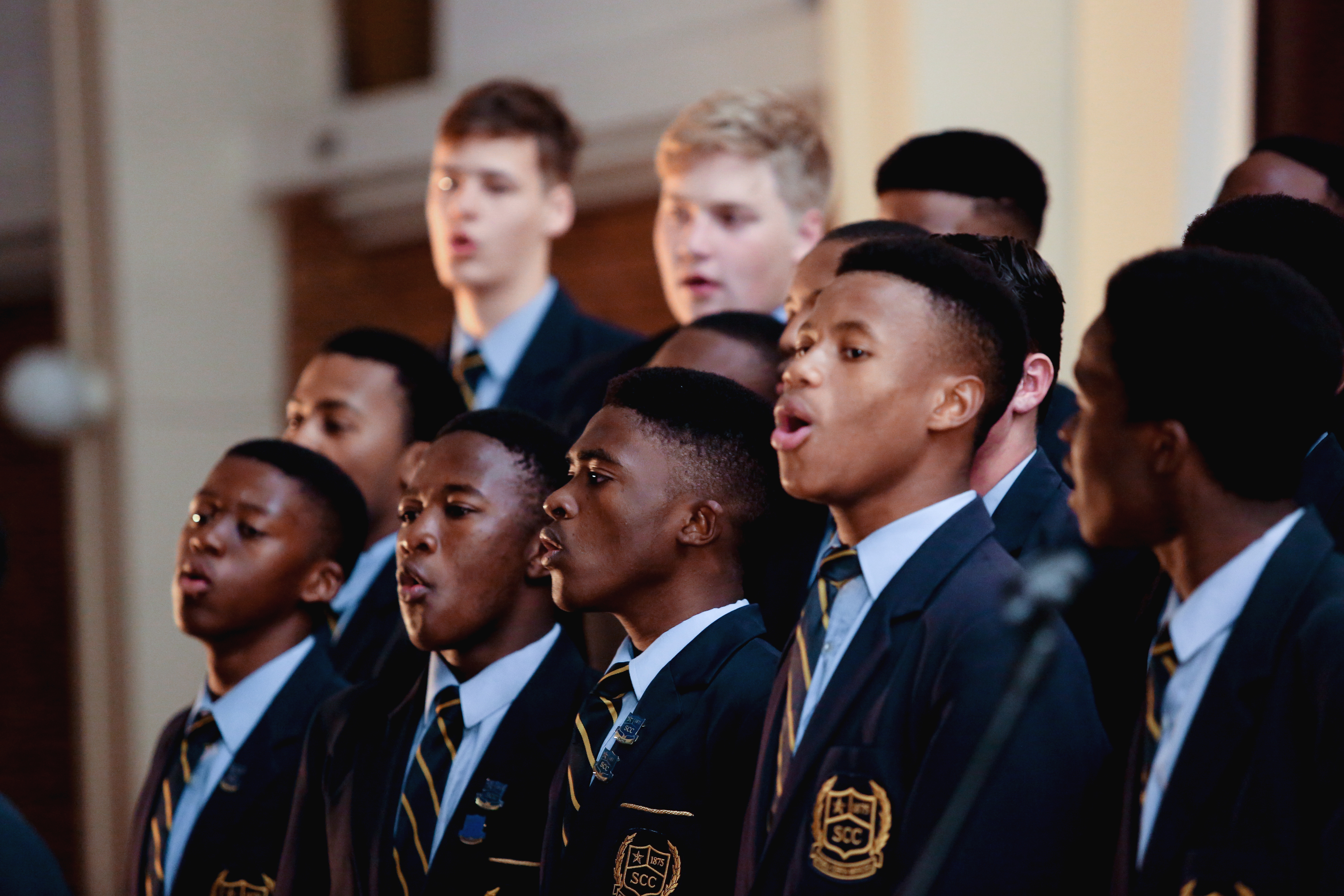 school students singing in a choir